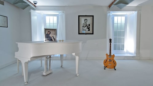 white instrument room with images of The Beatles in Liverpool