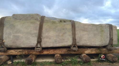 A giant stone tablet on wood planks at Stonehenge