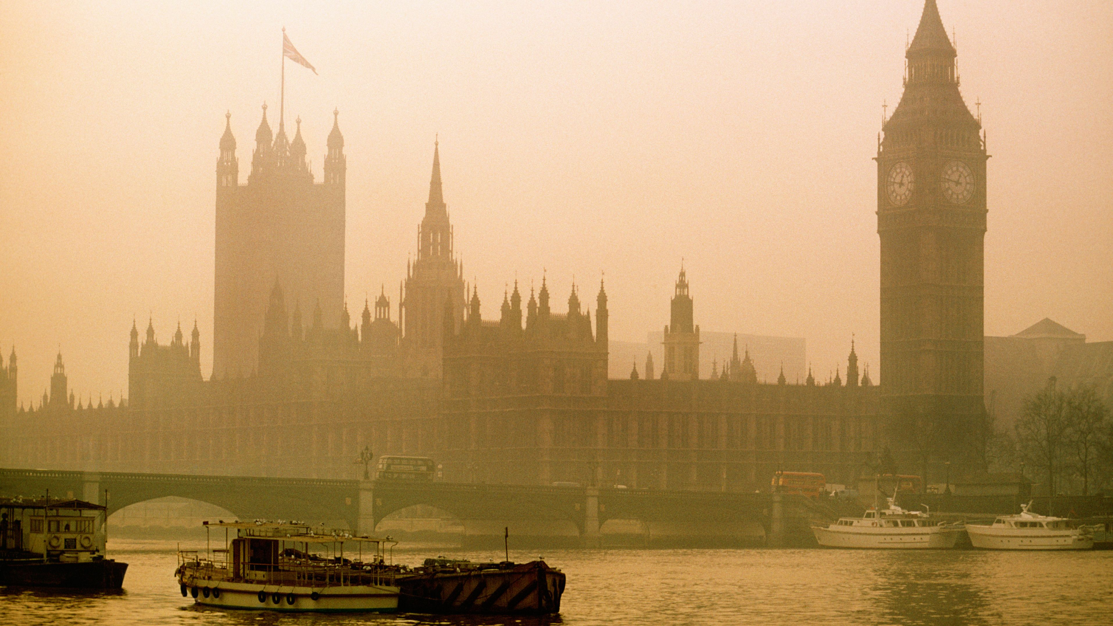 View of Westminster and Big Ben amidst fog, London, England
