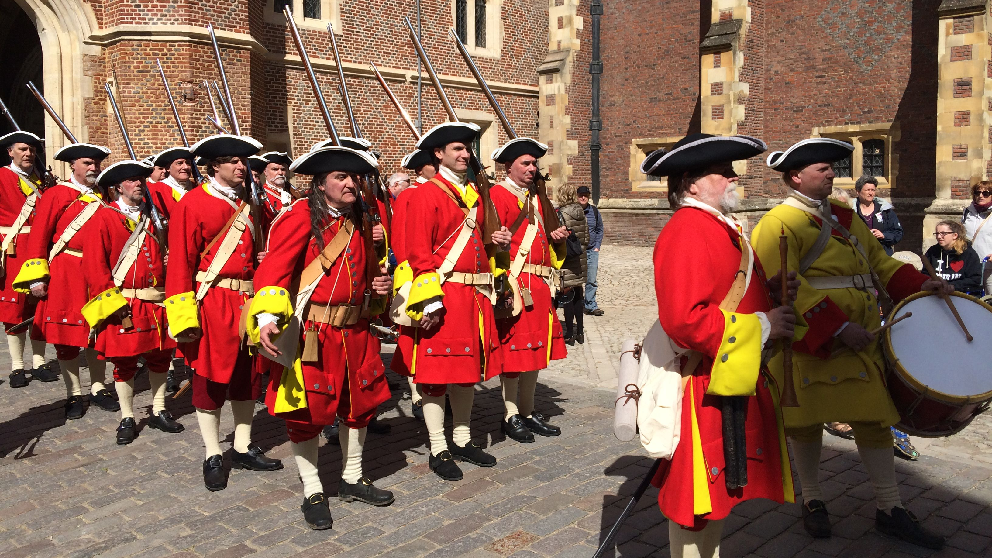 Englishmen reenactors dressed in red soldier uniforms on the street of London