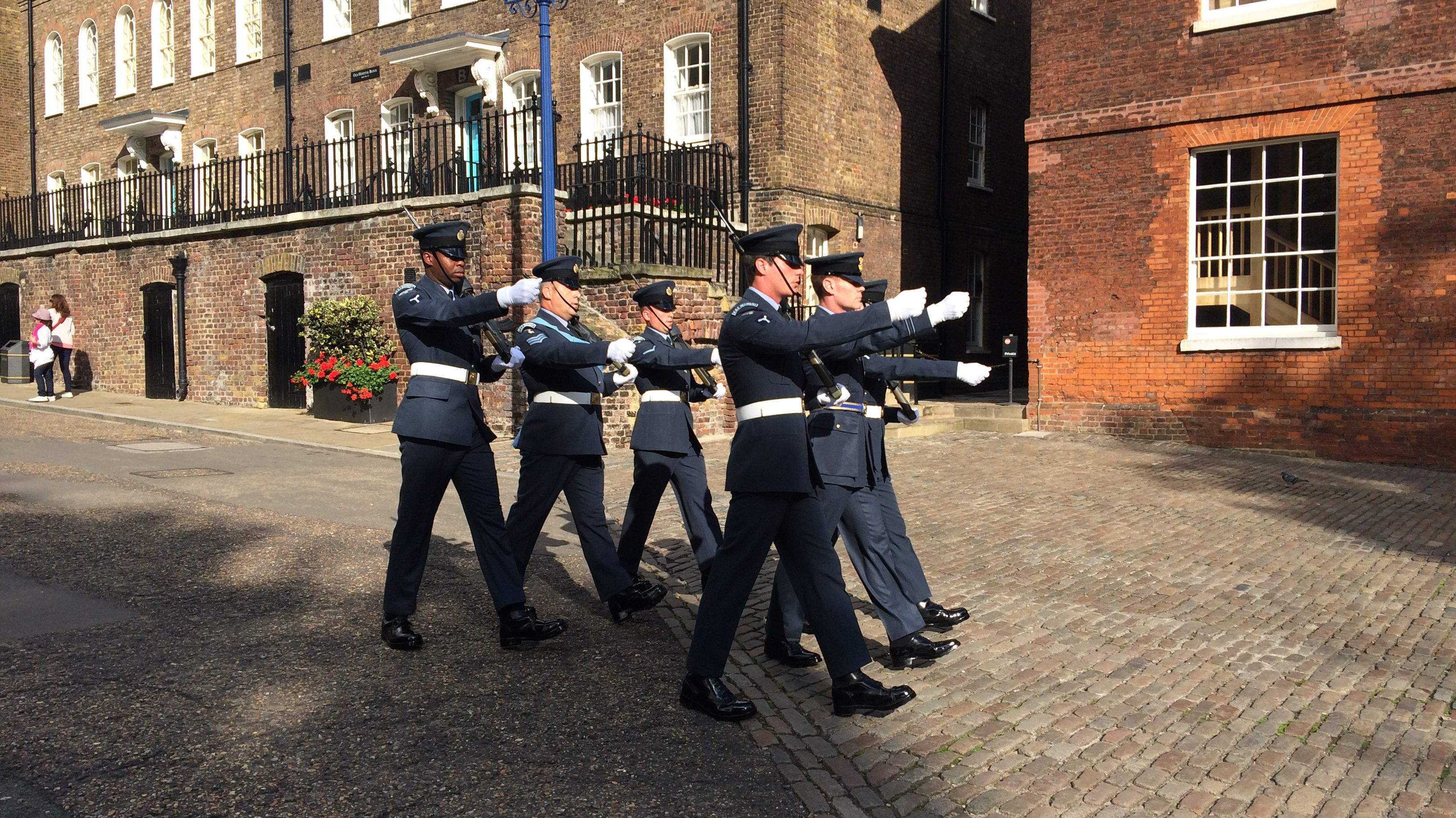 Six officers march in formation on the streets of London