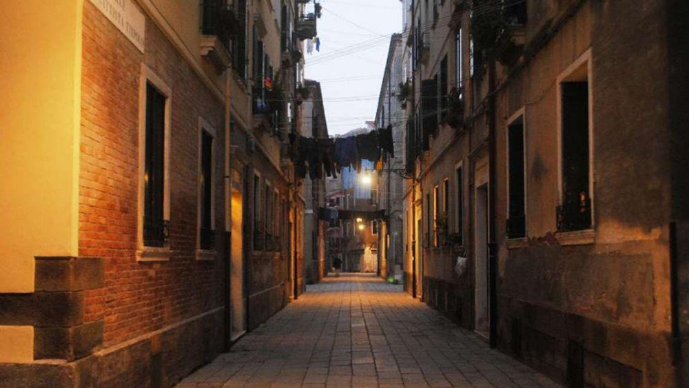 A lamplit alleyway in Venice