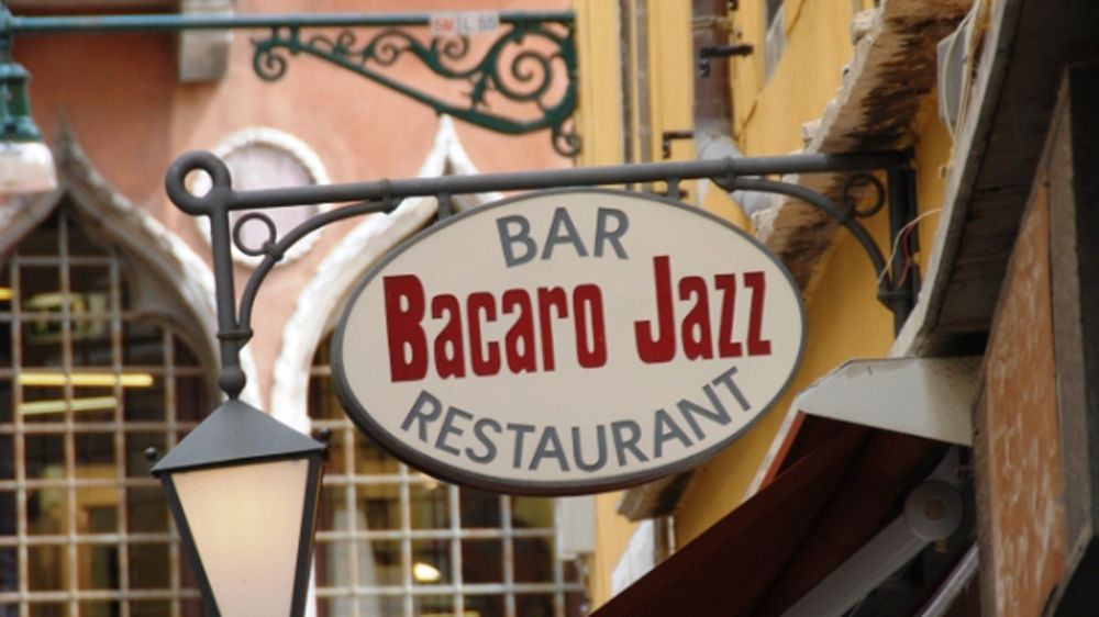 The outdoor sign for the Bacaro Jazz restaurant in Venice, Italy