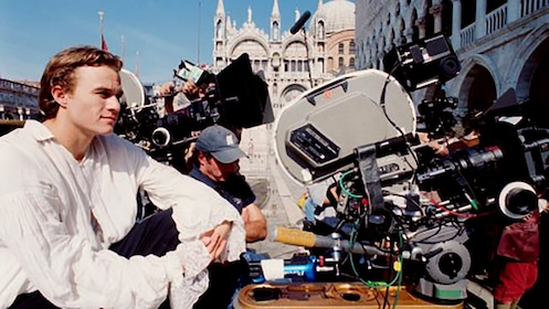 Heath Ledger on location in Venice sitting next to a movie camera
