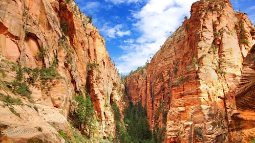 walking between two tall rocky cliffs in Nevada