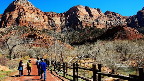 hikers walking along wooden fences in Nevada