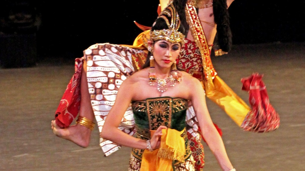 woman in traditional costume on stage in Indonesia
