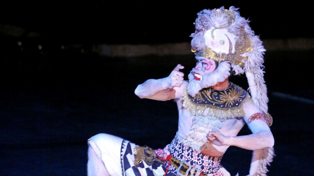 performer in white costume and makeup in Indonesia