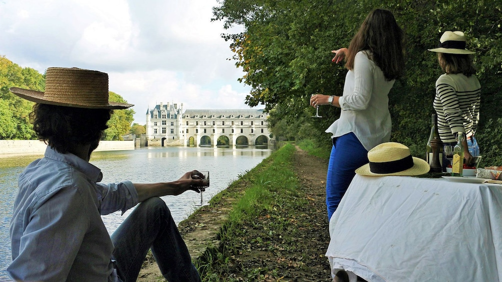 Show item 1 of 5. enjoying wine by the lake in France