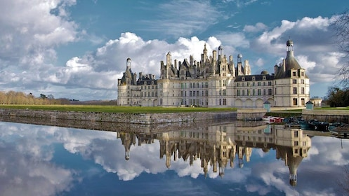 the Chateau de Chambord reflecting from the water in France