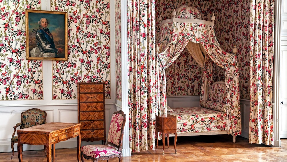 Show item 2 of 5. patterned wall and drapery inside the Chateau de Chambord in France
