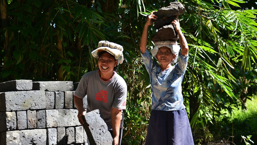 Tampilkan item 3 dari 9. Pair of native women at a sand quarry in Bali