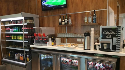 Beverage bar inside the Mera Business Lounge at Cancun Airport in Mexico