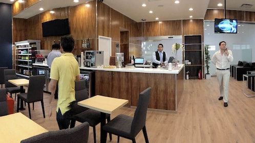 Travelers inside the Mera Business Lounge at Cancun Airport in Mexico
