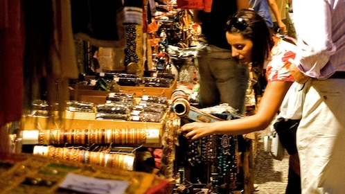 Girl shopping in jewelry at market
