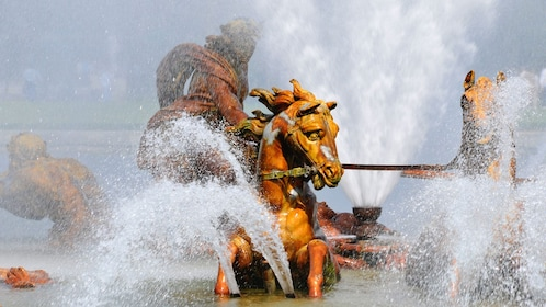 Fountain show featuring beautiful horse sculptures at Château de Versailles.