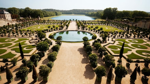 Ornate shaped hedges and pools of Versailles