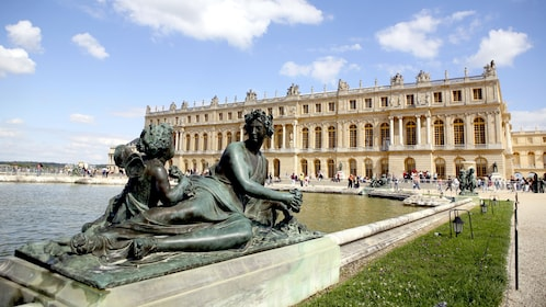 Statues and pool in front of Versailles