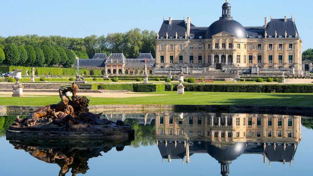 Show item 2 of 9. Statue in a pond in front of Vaux-le-Vicomte