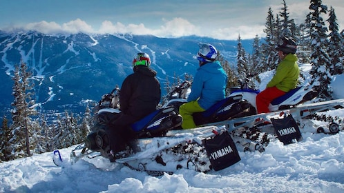 snowmobile riders taking in the view of the mountains in Whistler
