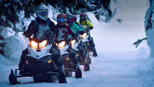 riding snowmobiles in a single file line in Whistler