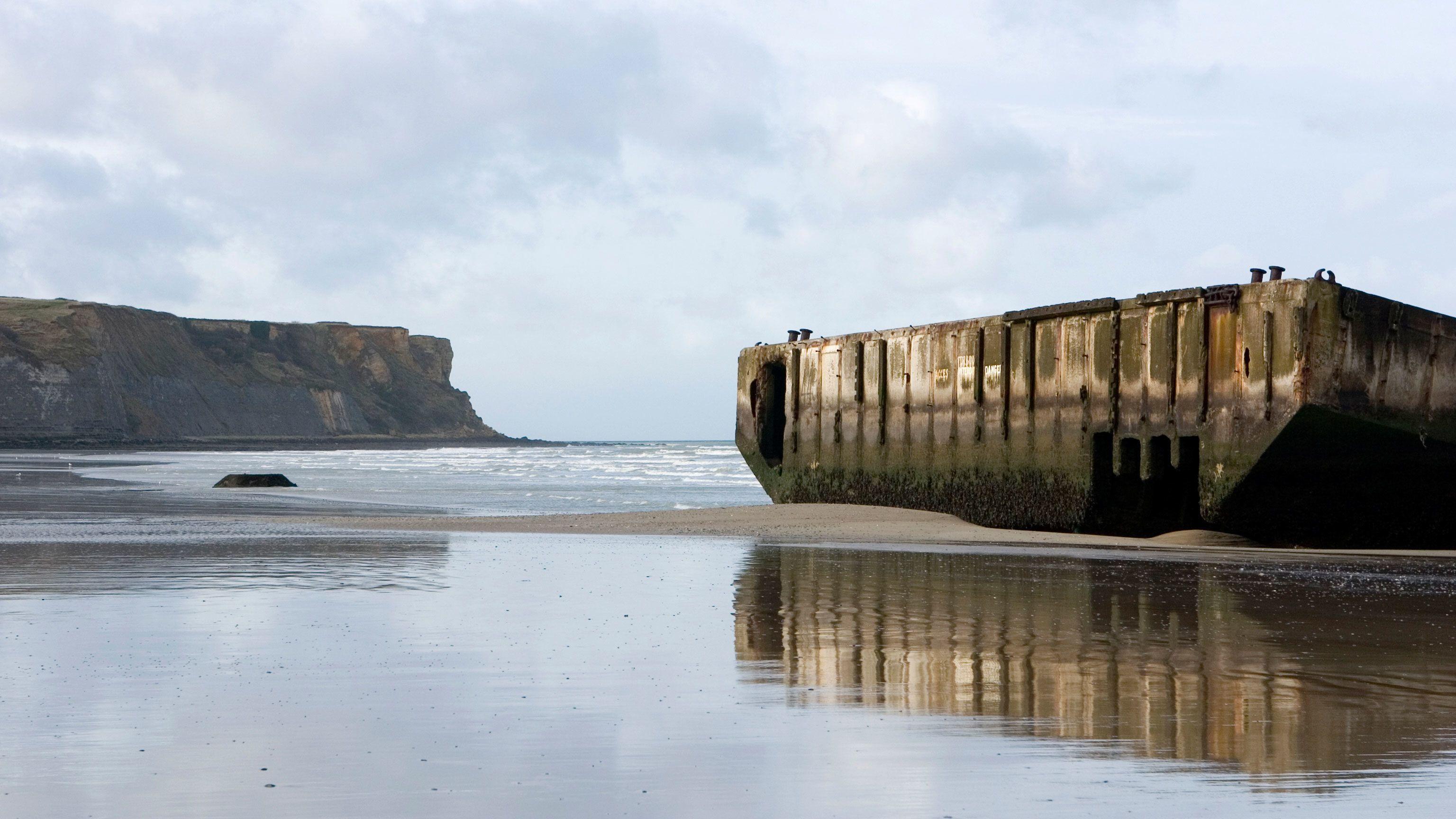 abandoned barge on beach