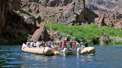 guide steering a raft full of passengers in Las Vegas