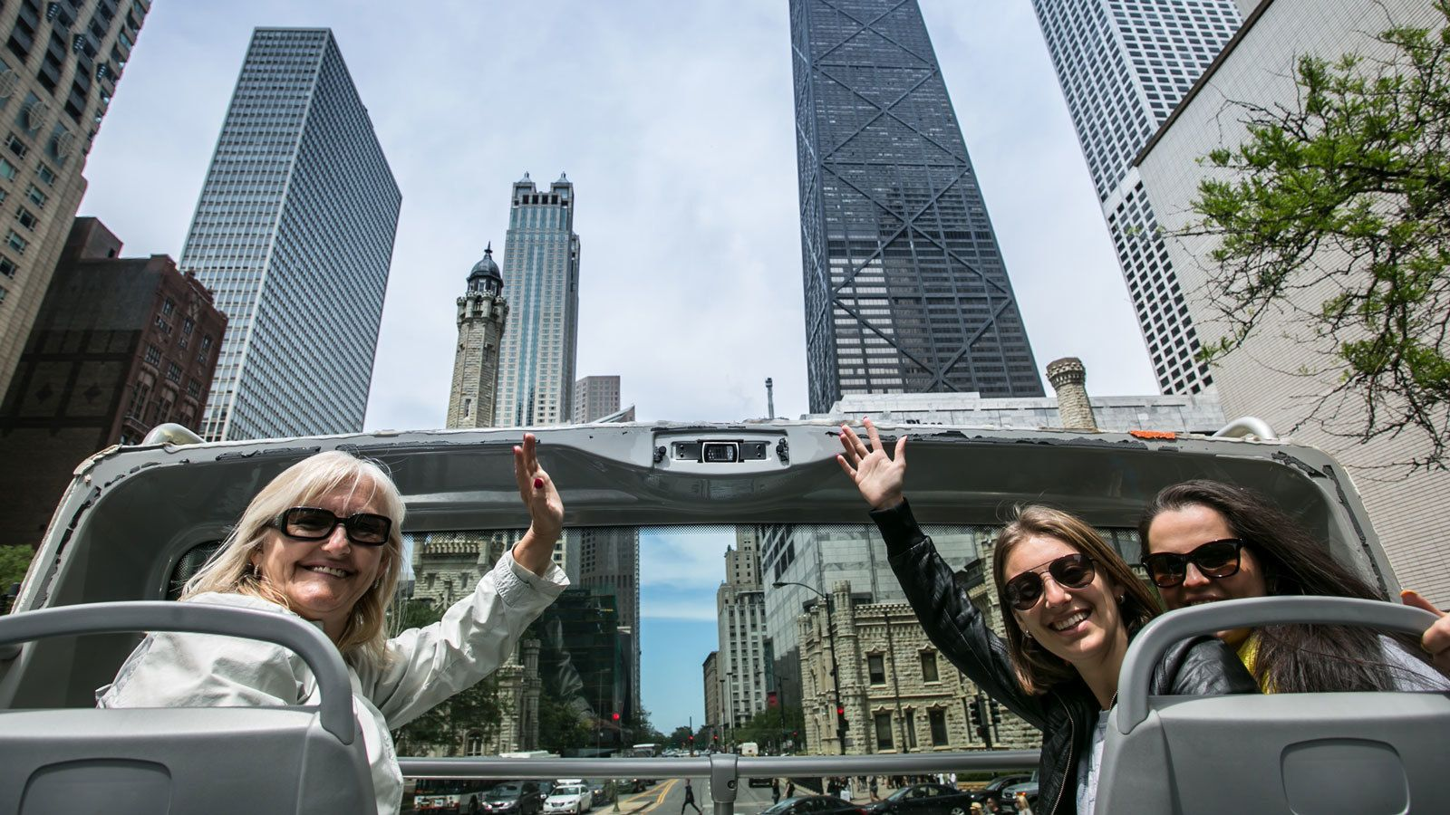 top deck bus riders waving in Chicago