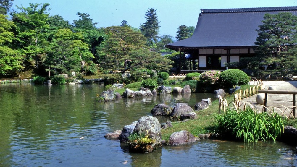 Show item 2 of 5. Koi pond next to a temple in Japan