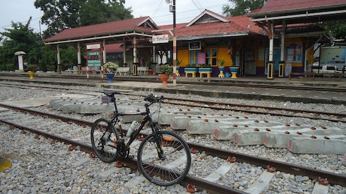 Bike parked on railroad tracks.