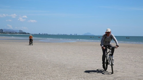 Bicyclists on the beach in Hua Hin
