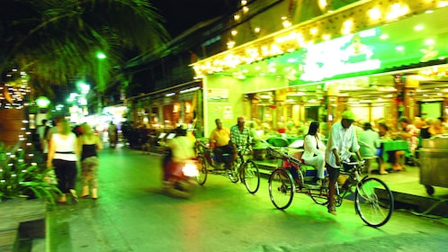 Bicyclists riding through the streets at night in Hua Hin