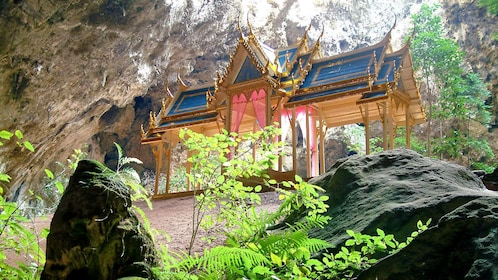 a small pagoda inside a cave in Thailand