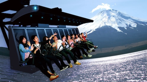 People on the Fuji Airways 4-D theatrical experience