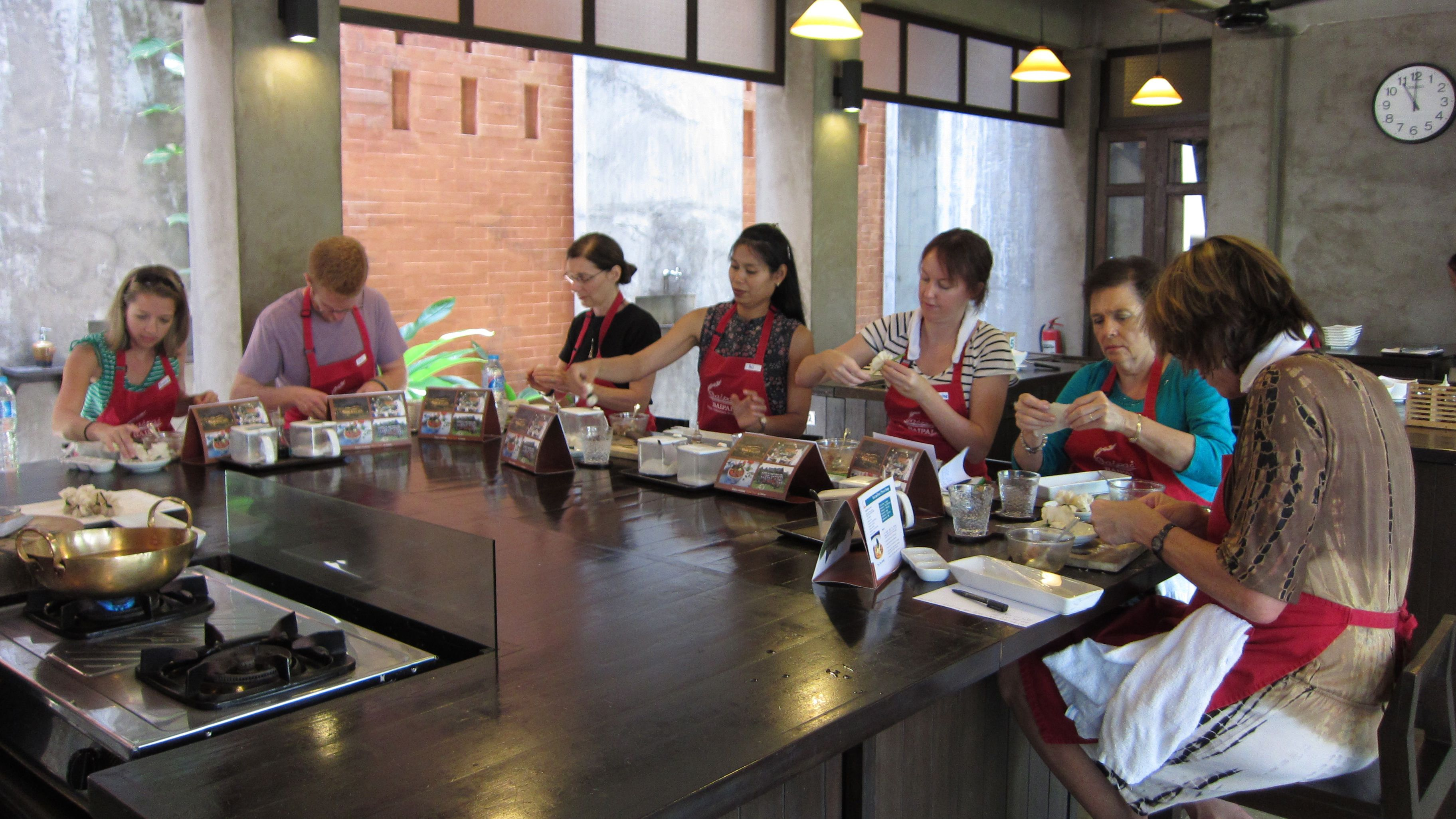 Seven people at a table in Bai Pai Thai Cooking School in Bangkok