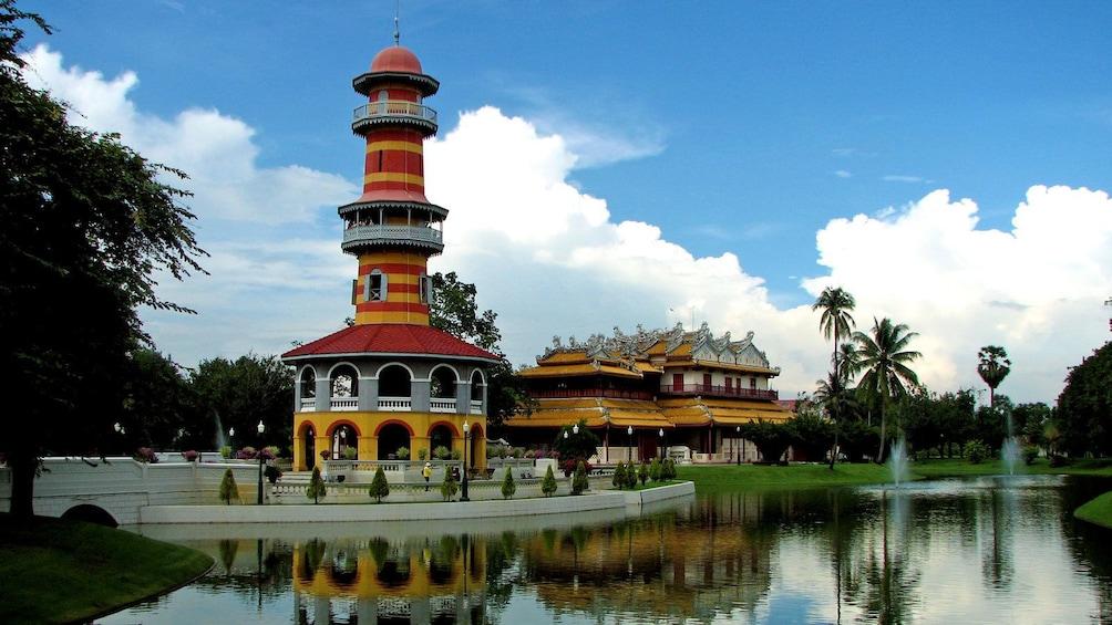 แสดงภาพที่ 3 จาก 5 a tall pagoda near a body of water in Thailand