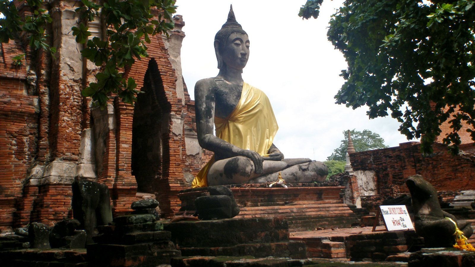 large Buddha statue at a brick temple in Thailand