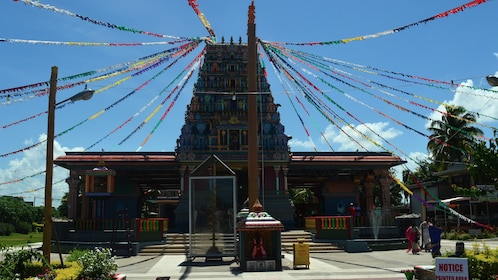 Temple with colorful streamers coming down from the roof in Fiji