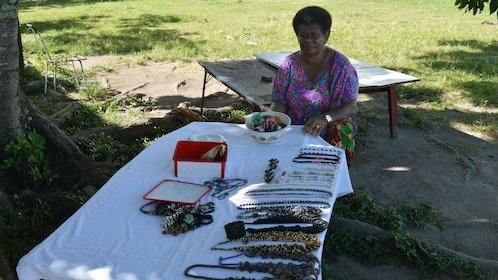 Woman at table of jewelry in Fiji