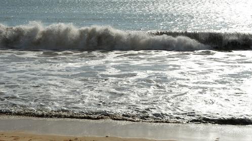 Waves crashing on the beach in Fiji