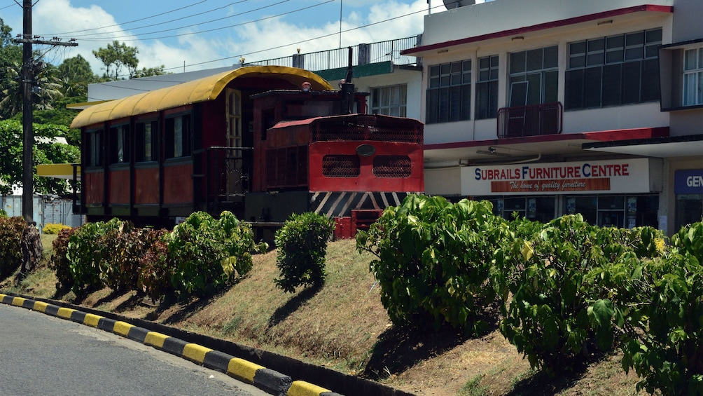Train traveling through city in Fiji