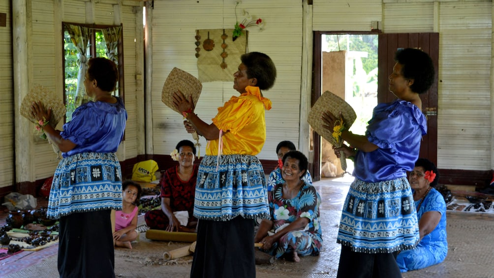 Women dancing with fans in Fiji