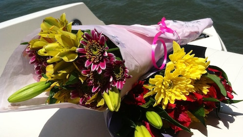 Two bouquets of flowers on a boat.