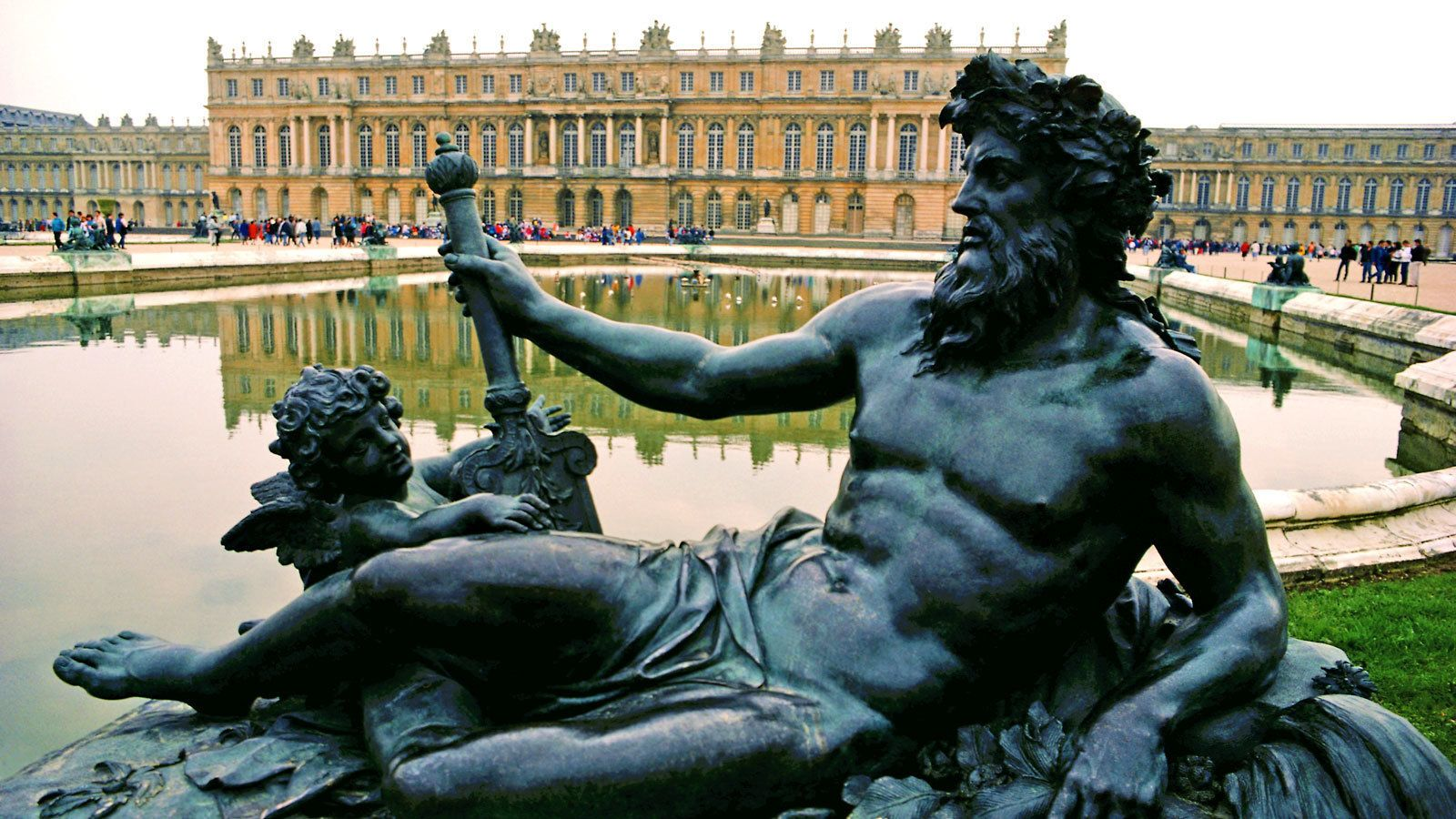 sculpture at the fountain outside of the Versailles Palace in France