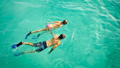 Snorkeling couple in the clear blue water of Punta Cana