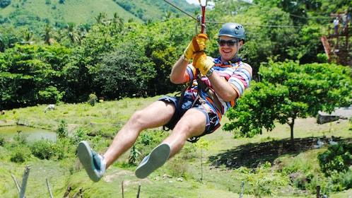 Man ziplining in Punta Canta