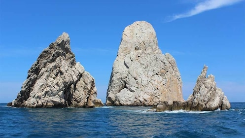 Trio of rock formations jutting out of the water in Costa Brava