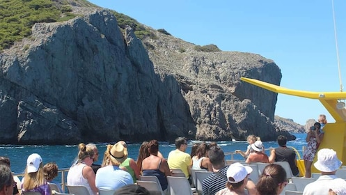 Boating group passing coastal cliffs in Costa Brava