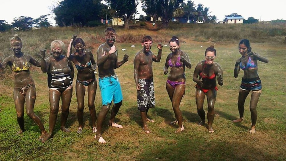 Group of people covered in mud in Fiji