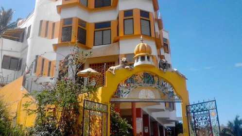 Yellow building with lion sculptures in Fiji